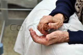 Hands of an old women during physiotherapy