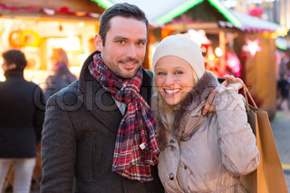 Young attractive couple in a christmas market