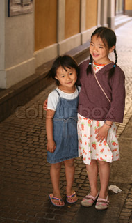 close up of happy chinese  children sisters