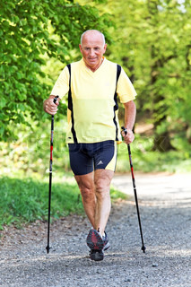 A senior training for fitness walking with Nordic