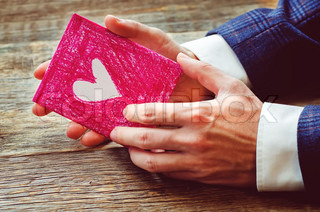 male hand holding card. Valentine's day.