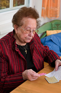 Old Woman with tablets and use information