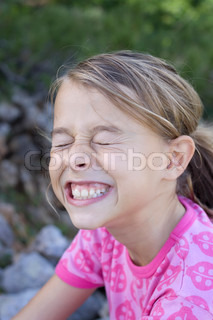 A 10 year old girl doing a funny face