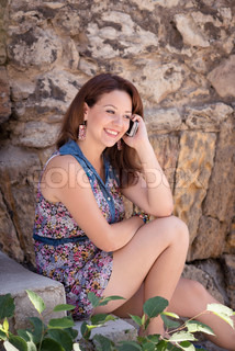Young beautiful girl talking on a cell phone
