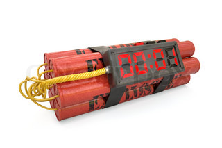 Explosives with alarm clock last second detonator isolated on white background