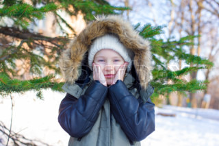 Little adorable girl outdoor during winter vacation