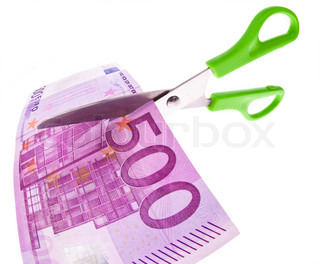 From a Euro bill is cut with scissors a piece. Symbol taxes and fees.