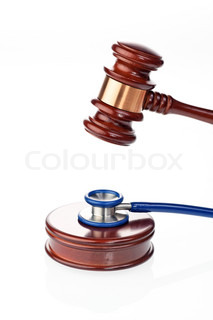Stethoscope and gavel as a symbol of medical error
