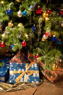 Christmas Presents under an antique decorated Christmas Tree