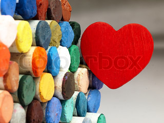 Heart and colored dry pastels closely.