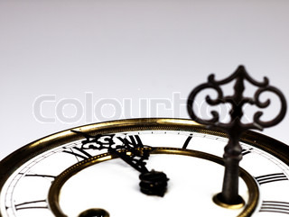 Old clock with roman numerals and key..