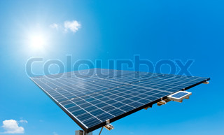 Sun shines on Solar Panel with blue Sky