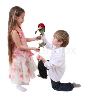 the little boy brings little girl flower red rose
