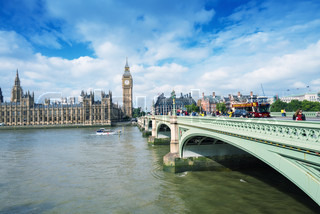 LONDON - SEPTEMBER 27, 2013: Tourists walk along Westminster Bridge on a beautiful sunny day. The city is visited by more than 30 million people annually