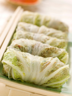 Plate of Steamed Pork and Vegetable Cabbage Rolls With Sweet Chili Sauce