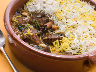 Close up of Pot of Lamb Biryani with a spoon