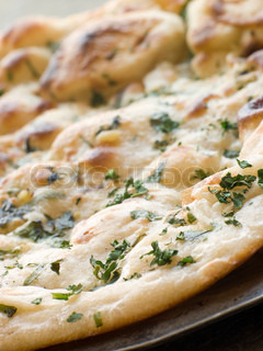 Plate of Garlic and Coriander Naan Bread