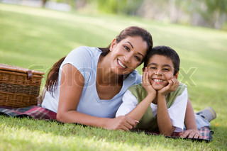 Mother and son having picnic in park