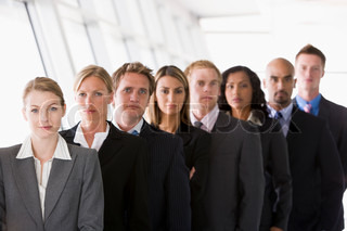 Group of office workers lined up facing camera