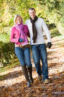 Young couple on walk through autumn woods