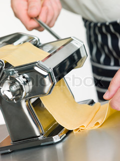 Close up of Fresh Egg Pasta being rolled in a Pasta Machine