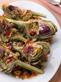 Plate of Roasted Globe Artichokes with Aubergine Peppers and Olives
