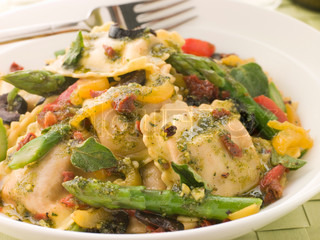 Plate of Roasted Vegetable Ravioli with Pesto Dressing Sun Blushed Tomatoes and Asparagus