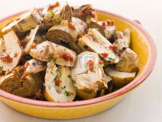 Bowl of Marinated Baby Artichoke Salad with Sun Dried Tomatoes