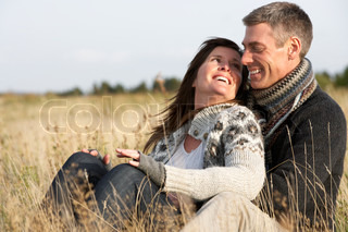 Romantic Young Couple In Autumn Landscape
