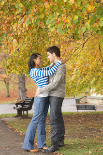 Romantic Young Couple In Autumn Park