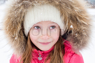 Portrait of adorable little girl outdoors on winter day