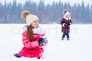 Adorable little girls outdoors on winter snow day