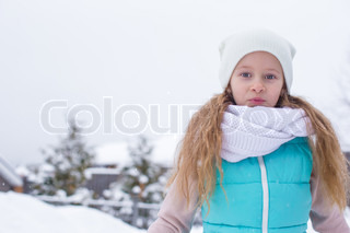 Portrait of cute little girl outdoors on warm winter day