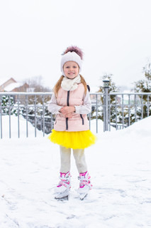 Adorable little girl outdoors in snow winter day