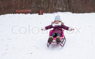 Adorable little happy girl have fun in winter snowy day