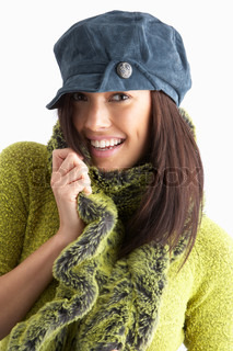 Fashionable Young WomanWearing Cap And Knitwear In Studio ...