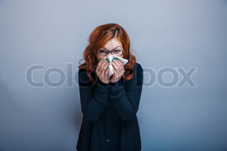 European-looking woman of about thirty redhead blowing his nose