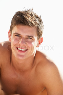 Teenage Boy Sitting On Beach