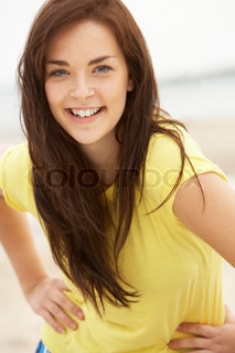 Happy Teenage Girl Having Fun On Beach