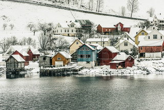 Wooden houses on the banks of the norwegian fjord beautiful mountain landscape in winter - The house on the rock the ultimate refuge in a norwegian fjord ...
