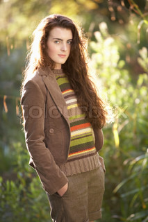 Portrait Of Beautiful Teenage Girl Outdoors In Autumn Landscape