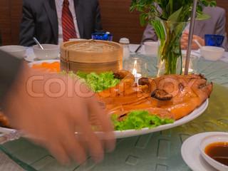 serving roast suckling pig