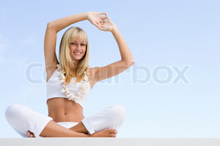 Woman doing yoga outside wearing shell necklace