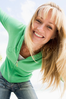 Young woman relaxed and happy outside