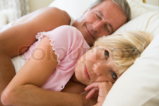 Image of 'bed, couple, woman'