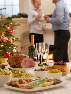 A couple celebrating the holiday with Christmas dinner