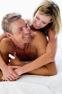 man and women on a bed cuddling