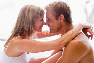 man and women cuddling indoors
