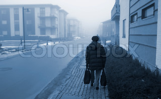 Elderly woman on her way home after the daily shopping - Denmark.