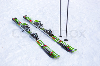 Pair of skis and and ski sticks on snow